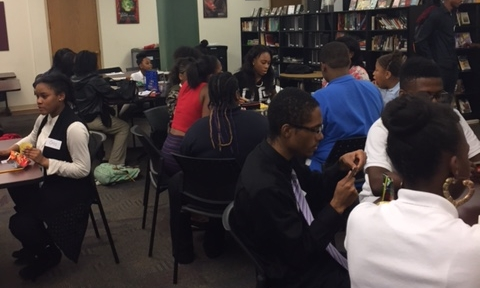 High school students get to know their middle school mentees.
