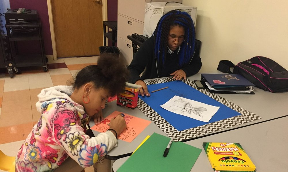 Urban Pathways students work on their poster for the school's Bullying Prevention Month contest.