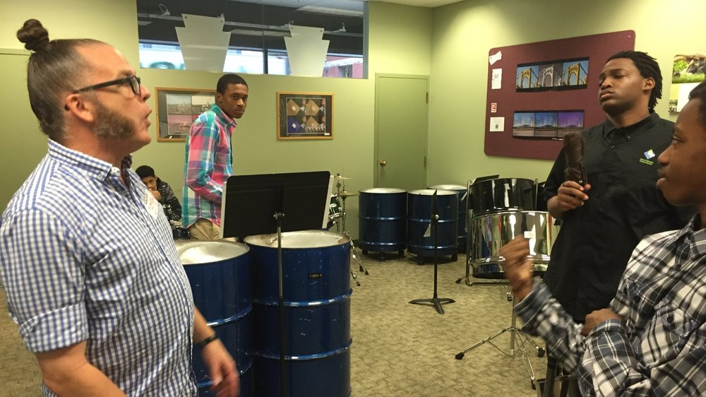 steelpan students work with Dutch artist Allard van Hoorn