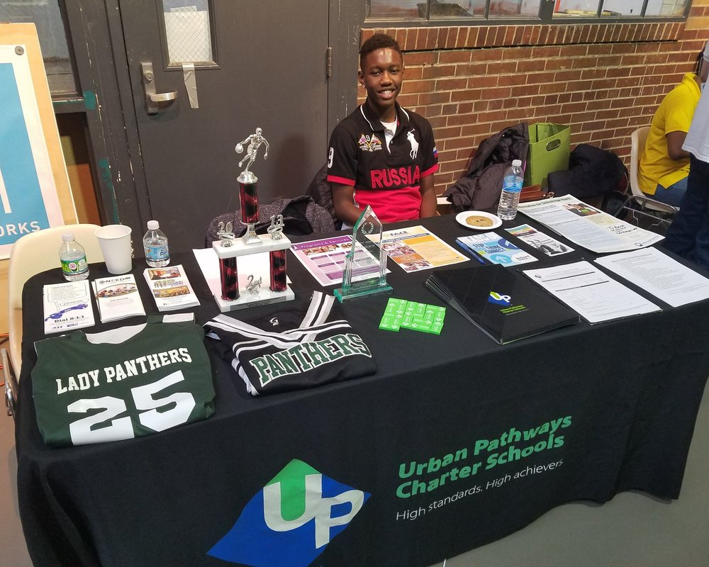 UPCS 6-12 table at the school choice fair