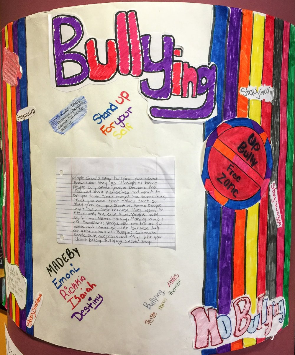 Urban Pathways 6-12 middle school group Anti-Bulliyng Poster contest winner by Emoni, Rickkia, Isaiah, and Destiny.