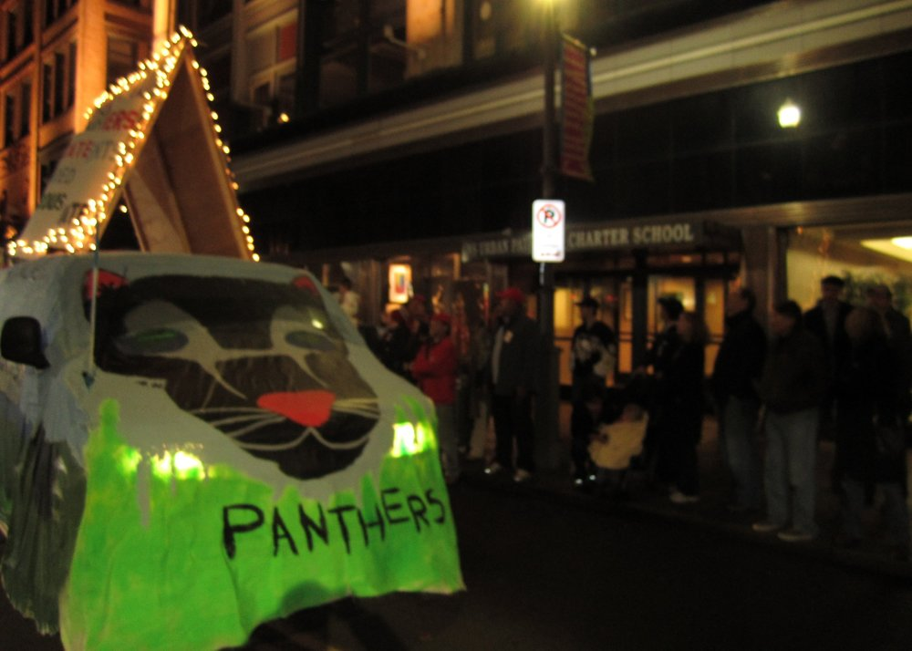 Urban Pathways Charter School float passes our school in the First Night Parade