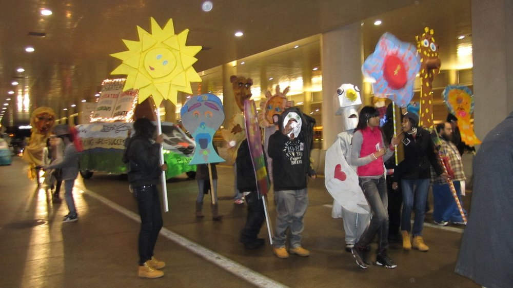 Urban Pathways students carrying their full sized puppets