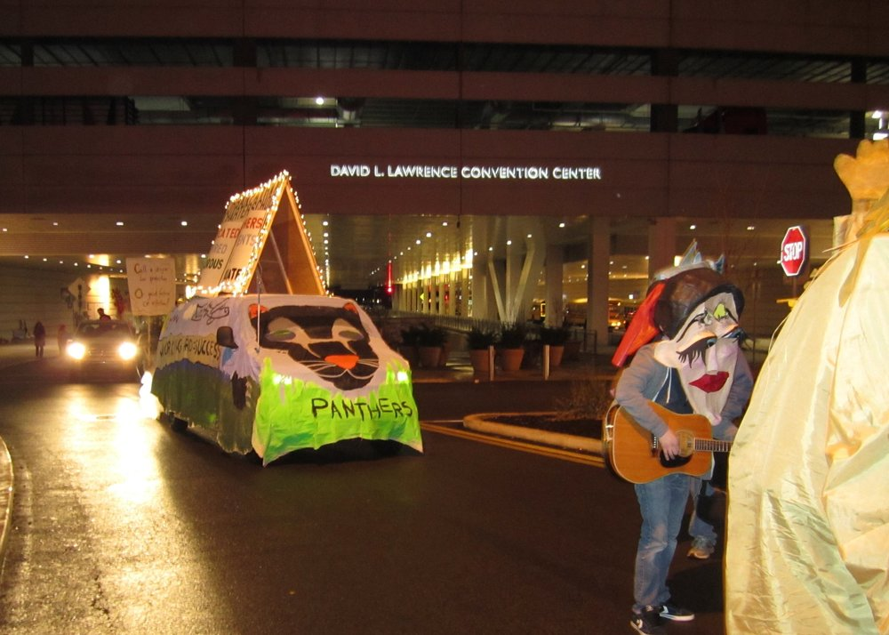 UPCS 6-12 float leaving the convention center