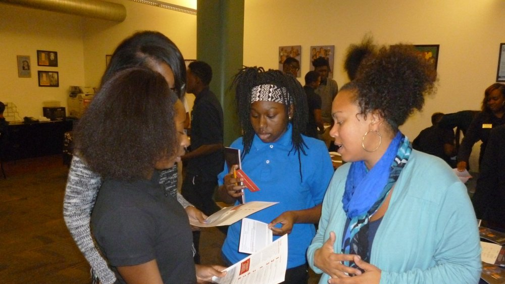 Urban Pathways students talk to a CCAC representative