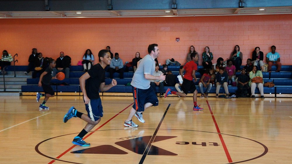 Urban Pathways 6-12 Staff plays basketball against student for charity