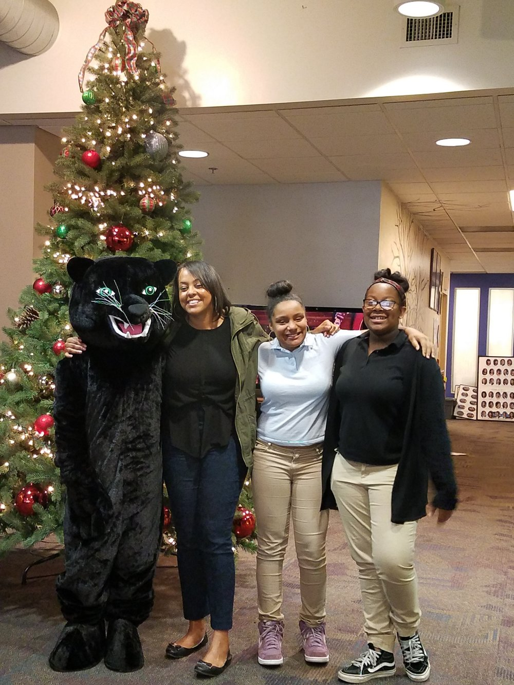 Urban Pathways Panther with students and staff