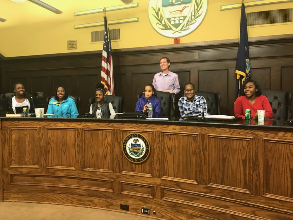 Urban Pathways 6-12 Middle School Student Council members sit at the bench in Allegheny County Council