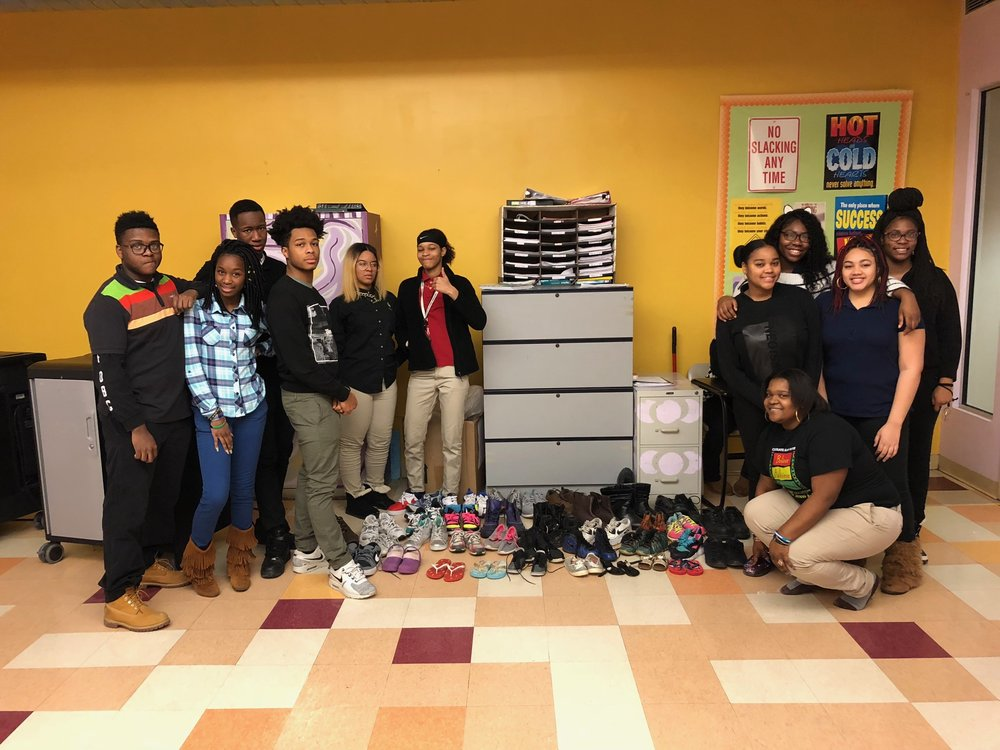 Interact Club at UPCS 6-12 with the donations for the shoe drive for Niacaragua