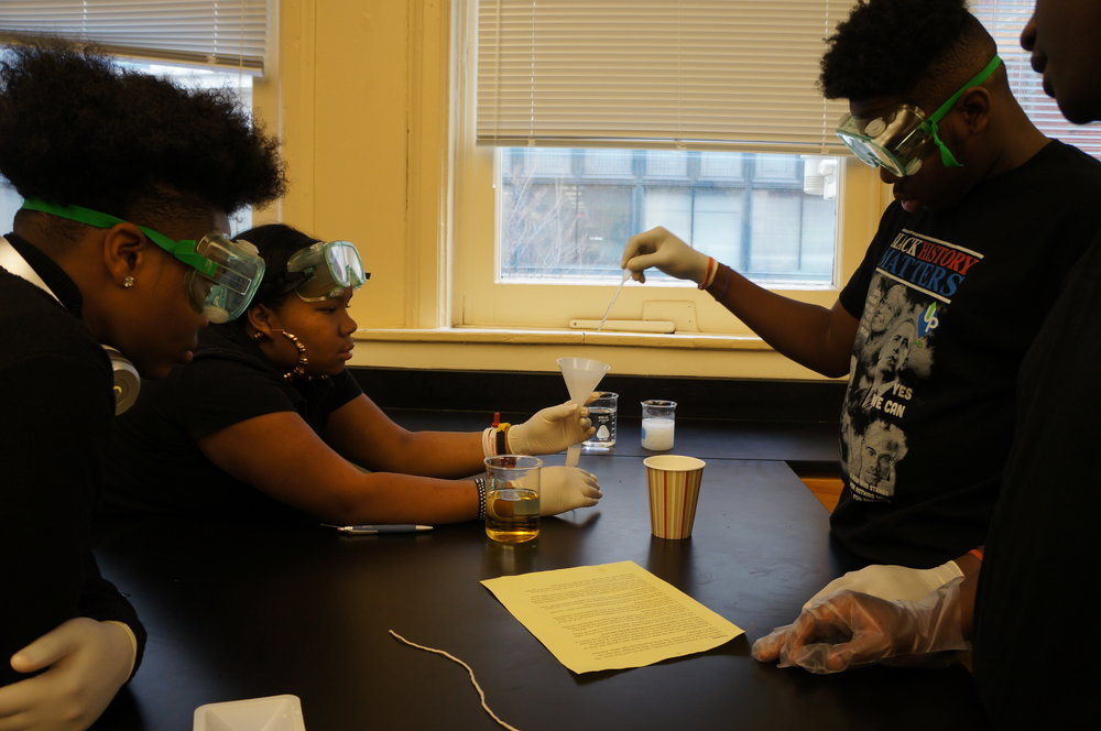 UPCS biology students measuring starch and glucose solutions into the tube