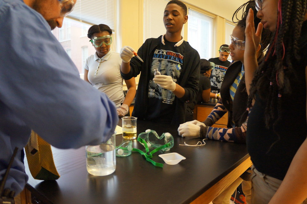 preparing an iodine solution at Urban Pathways 6-12 Charter