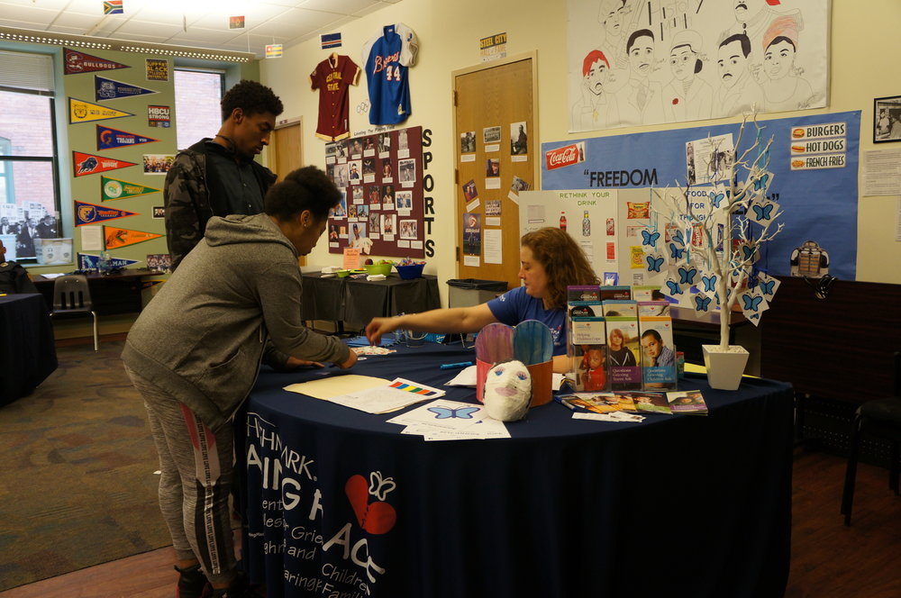 Highmark Caring Place explains their services at the UP 6-12 Health Fair