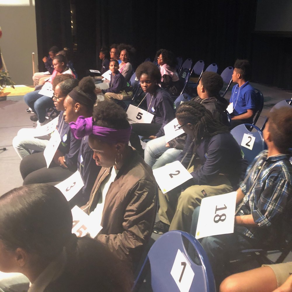contestants on stage at CCAC for the Urban Pathways Spelling Bee competition