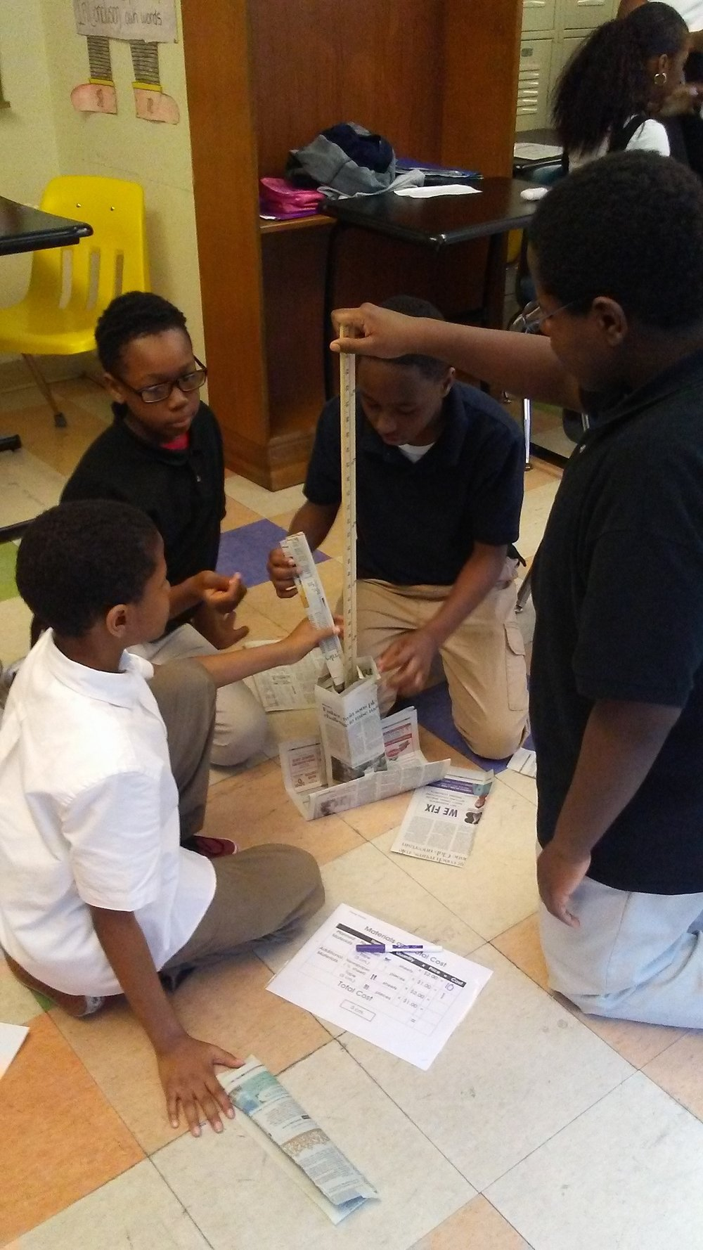 Urban Pathways students build towers in a sustainability lesson