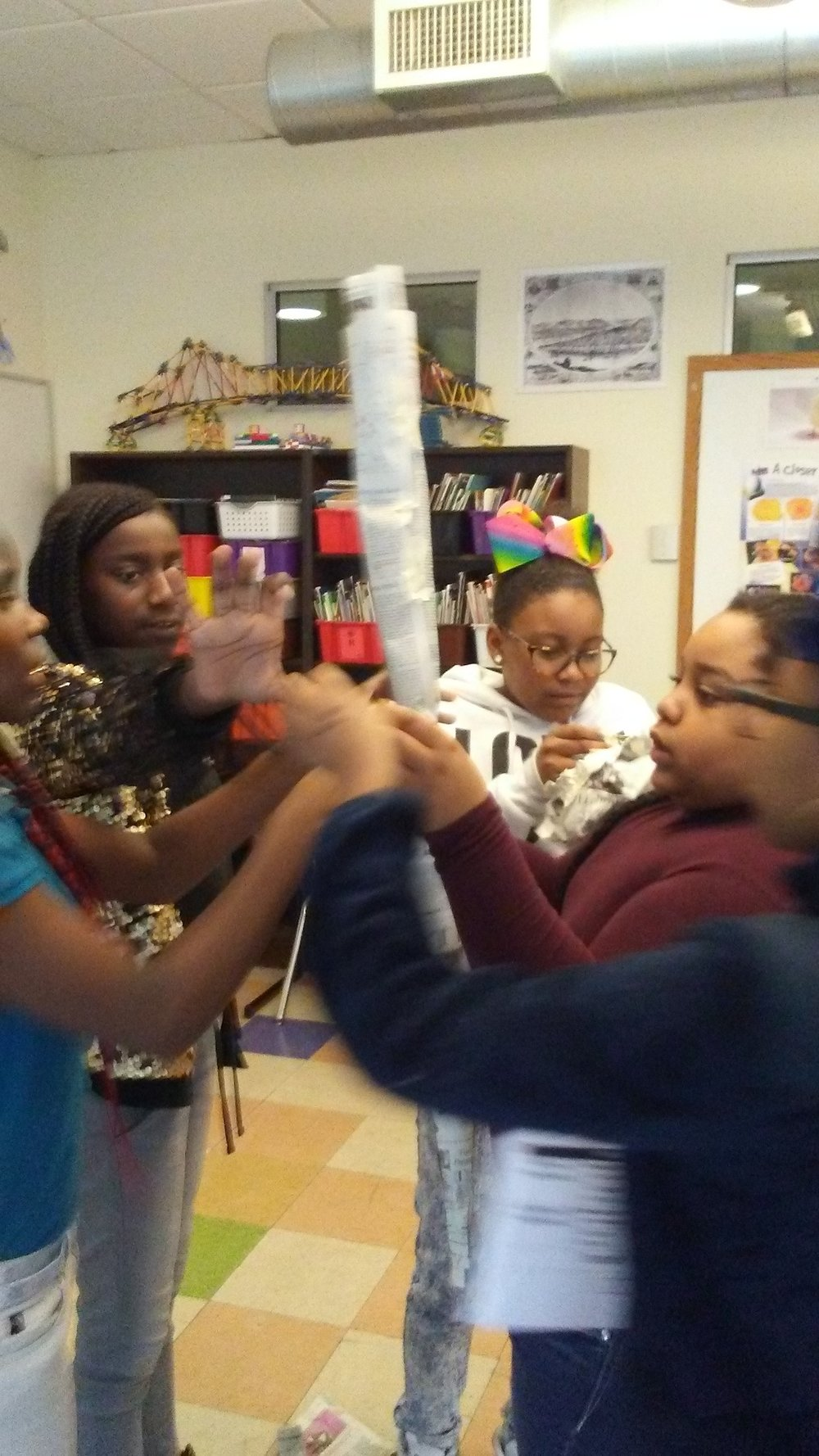 UPCS 6th grade students build towers in a sustainability lesson