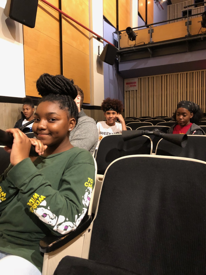 Urban Pathways students practice for their blind cinema performance