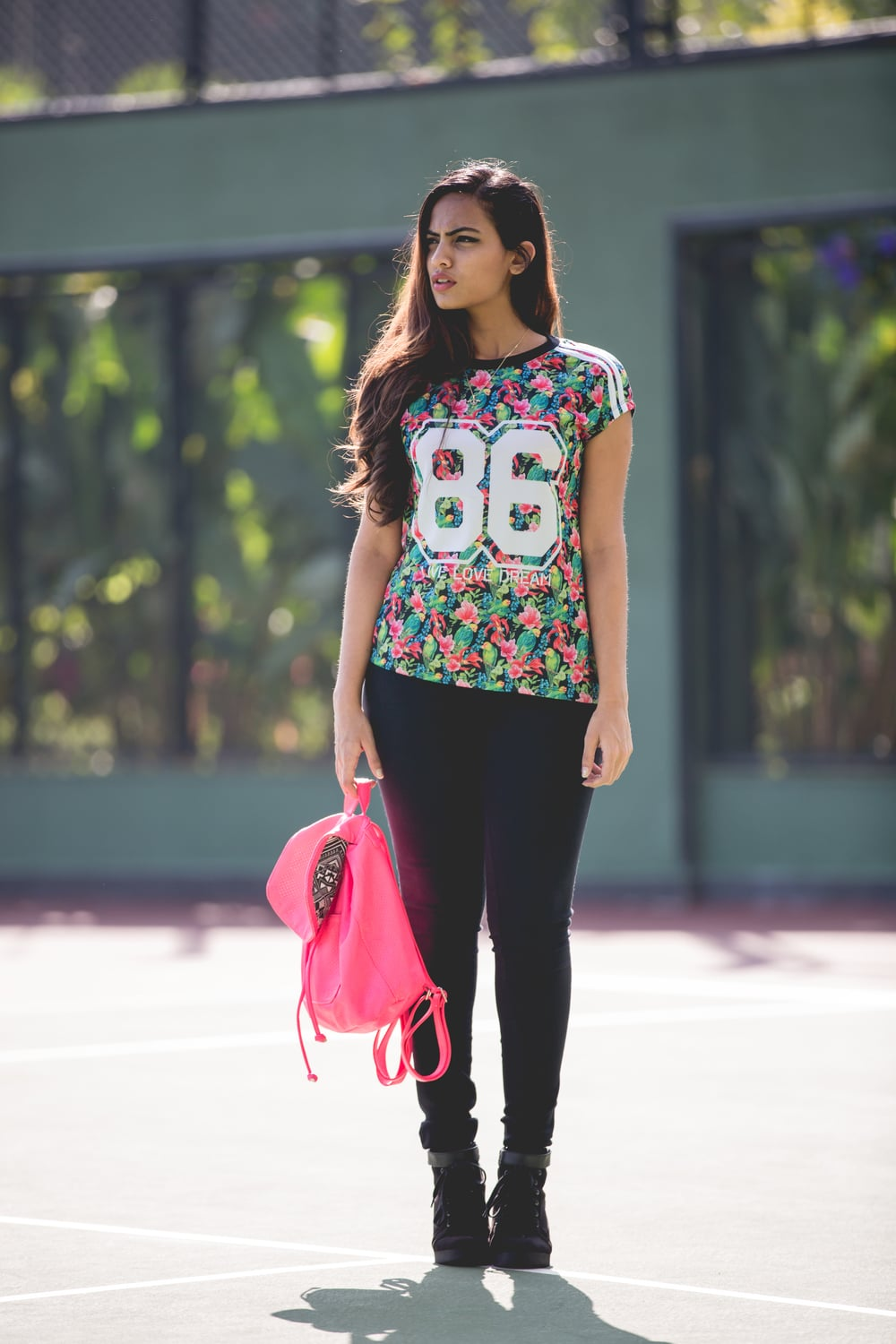 T-shirt , Jeggings , Necklace - Unlimited Stores ; Wedged Sneakers - H&M ; Backpack - Victoria's Secret PINK