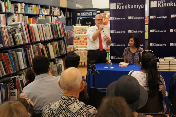 John Fuller, Kinokuniya, welcomes the audience
