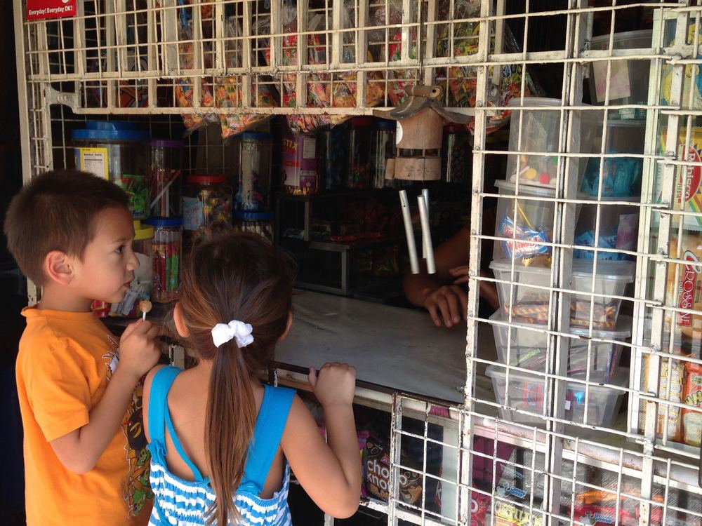 Exploring their options on what to buy for the 5 pesos they found under Lola's couch