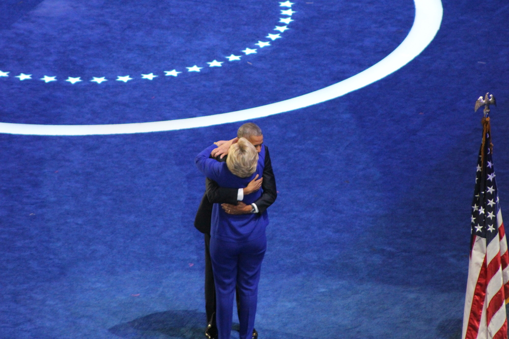 Barack Obama and Hillary Clinton share a hug. (Sarah Burris, Flickr)