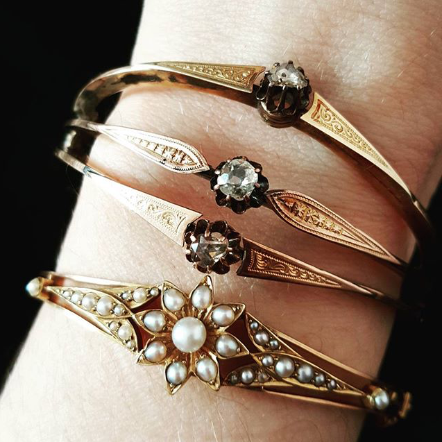 A stack of antique bracelets from The Idol's Eye.