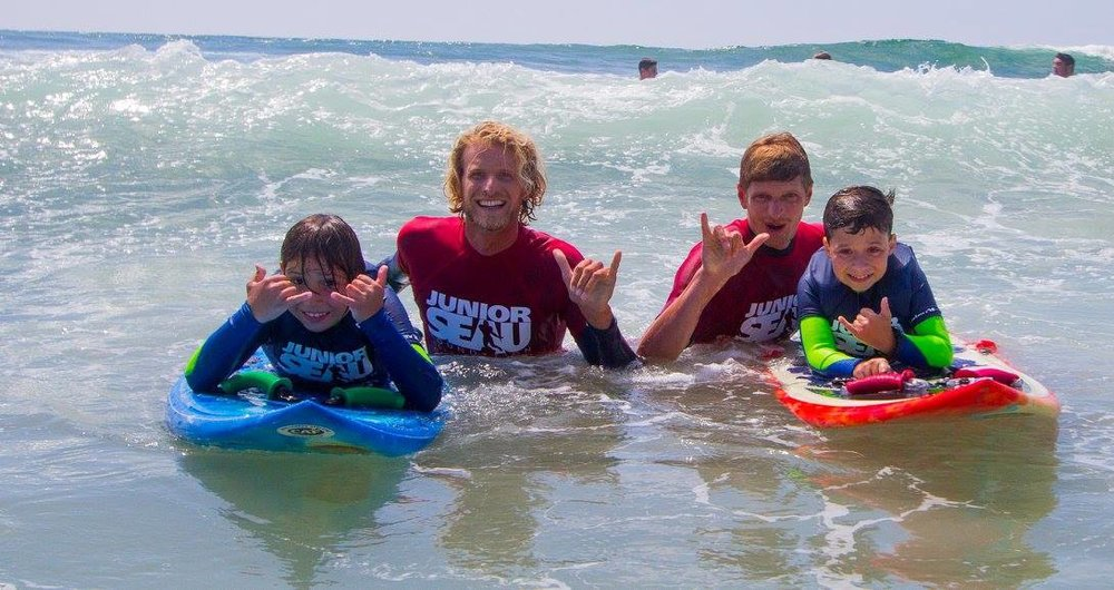 Nikki Harth and fellow ISA Surf Instructor Alex Reynolds helping kids get stoked on surfing at the Junior Seau Foundation Adaptive Surf Program presented by the Challenged Athletes Foundation.