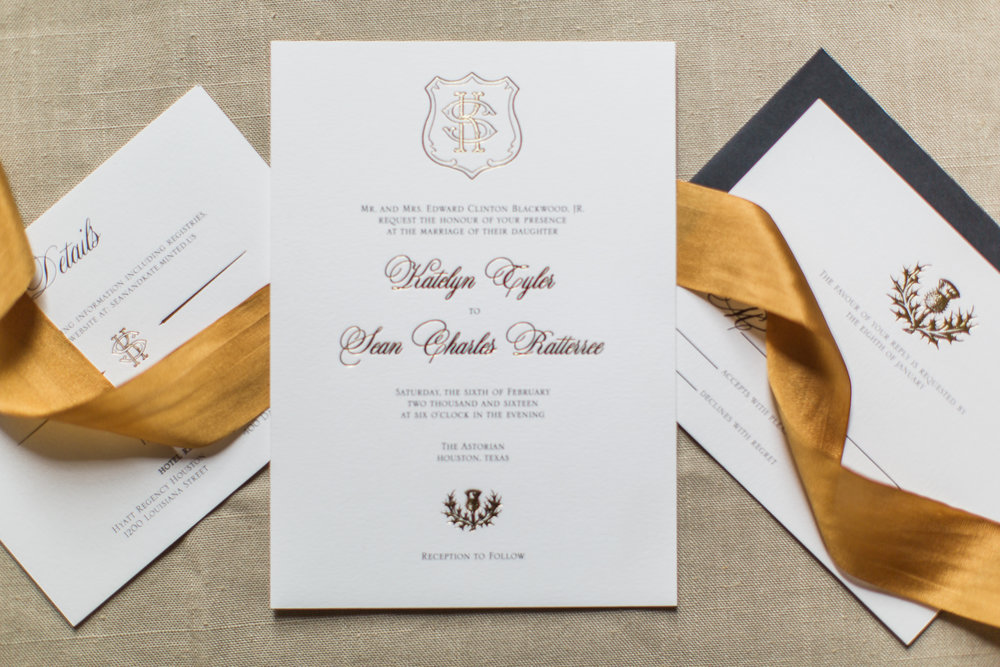 The custom crest, names and thistle were all foiled in this stunning suite. Photo by  Lindsey Larue Photography