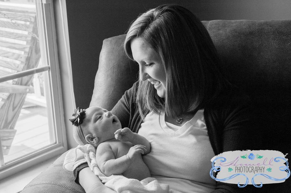 Cleveland TN Newborn Lifestyle Mom Holding Baby By Window
