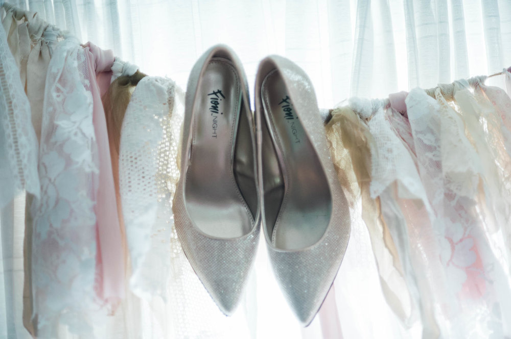Shoes hanging at the barn at high point farms wedding