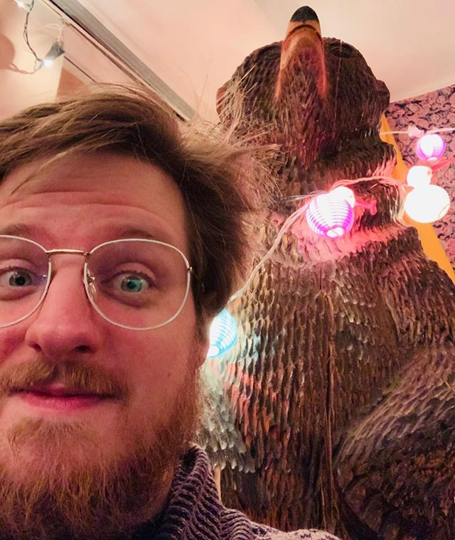 "I forgot to mention I'm sitting in front of a bear statue at this show. Also there's a fridge full of about 200 PBRs right inside the door, and the performer is begging us to take as many as possible, and the Public's slogan is now basically ""We're Not Cops, Man"""