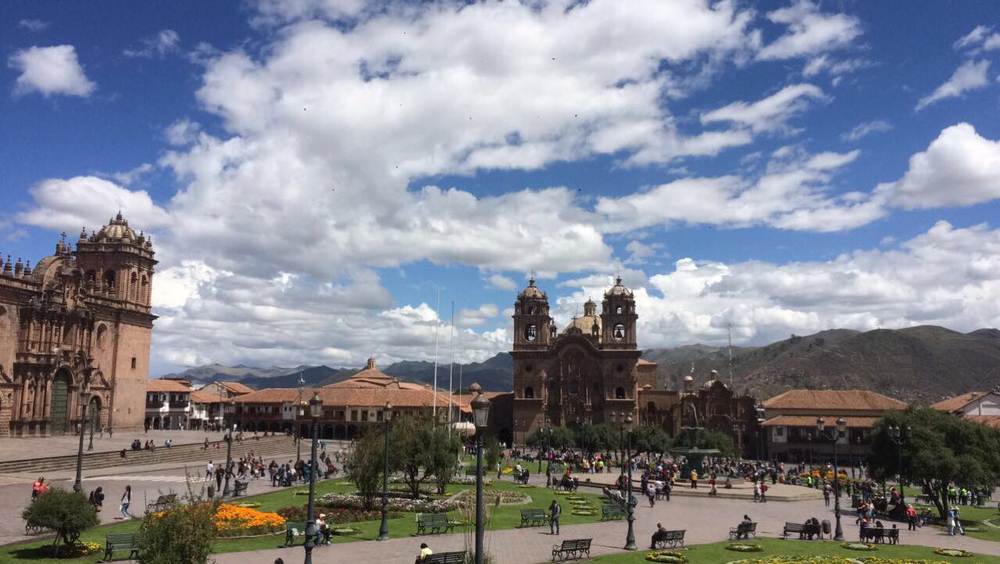 #foodisourfriend travel: Plaza de Armas, Cuzco Peru by day. Cathedrals, shops, restaurants, tourists, local and homes sums up Cuzco.