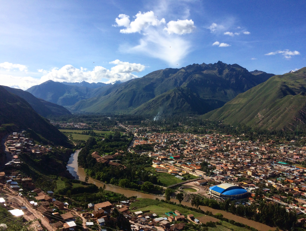 Valle Sagrado, Sacred Valley Peru by day. That river has been sacred to the Incas because it helps bring life to the people. There are so many ruins to climb, including Macchu Picchu and the Sacred Valley ruins. There's also very good shopping! It's my favorite part of my Peru Trip.