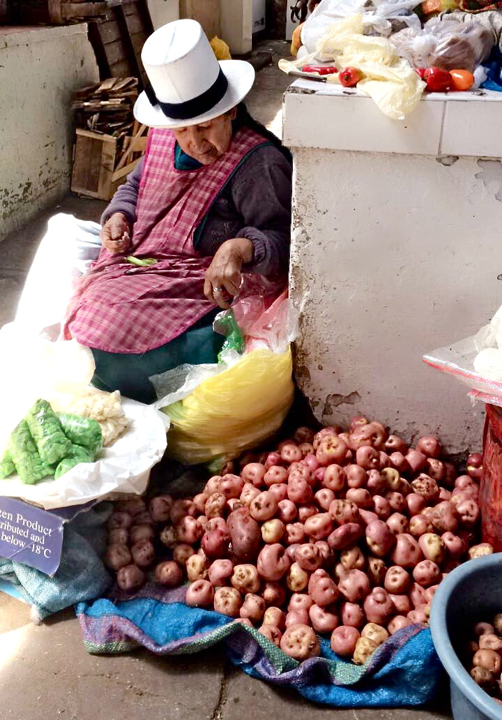 #foodisourfriend travel - market Mamita selling potatoes, veggies
