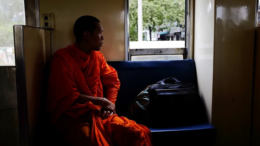 A monk on the train. Bangkok. 2017.