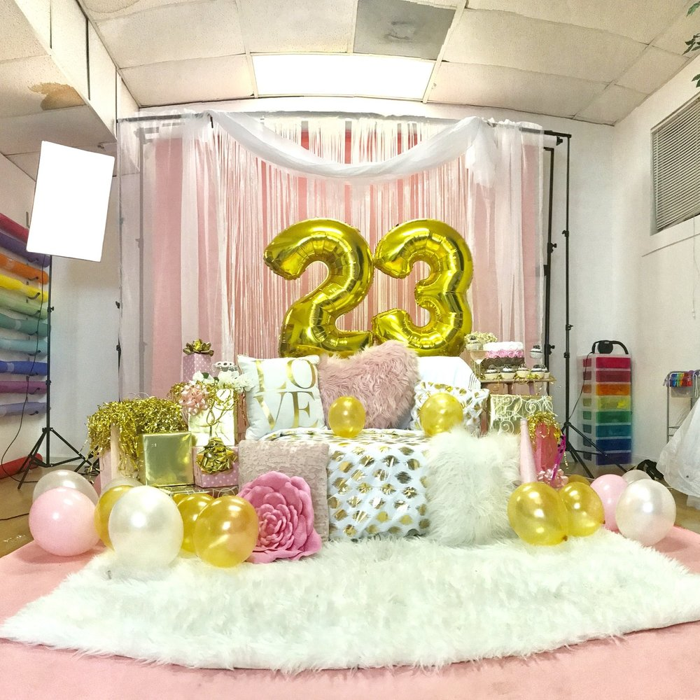 Client only provided   #23 balloons, pink gift bags, her laptop and phone, and the pink polka dot wrapped boxes that she specifically wanted to include to this set.