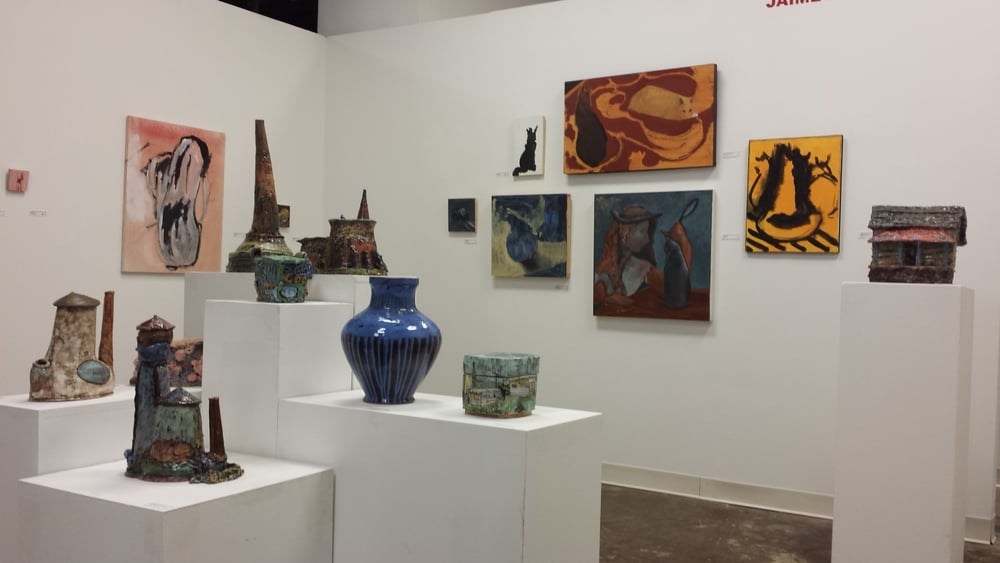 Jamie Mesenheimer's work is hanging along with my pots and sculpture. I love how her expressionistic paintings work so well with my work.