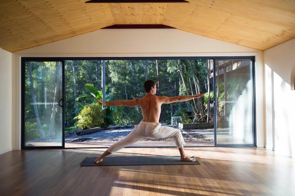 Nick_bradley_yoga_Pose_warrior_2_akhanda_yoga_teacher_training_Gold_coast_yoga_studio_banner.jpg