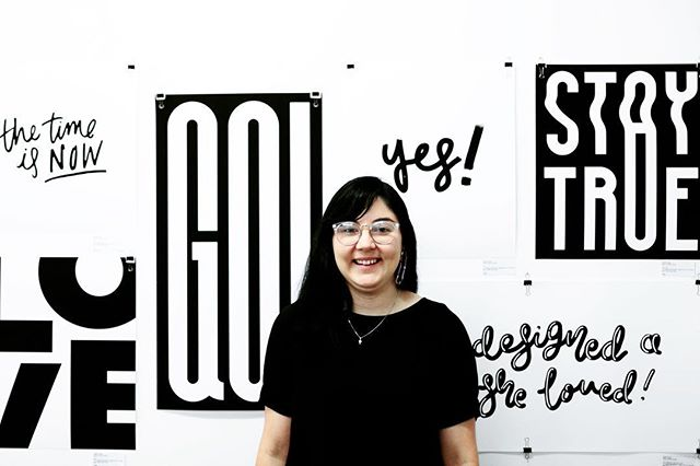 Here's a pic of yours truly alongside my work! If you don't know already, my name is Hollie and I'm the designer behind Black & White Studios! I'm so happy in this photo because I'm surrounded by letters and that's how I hope to spend the rest of my life! 👏🏻🖤 Photo by @itssamblyth 📸