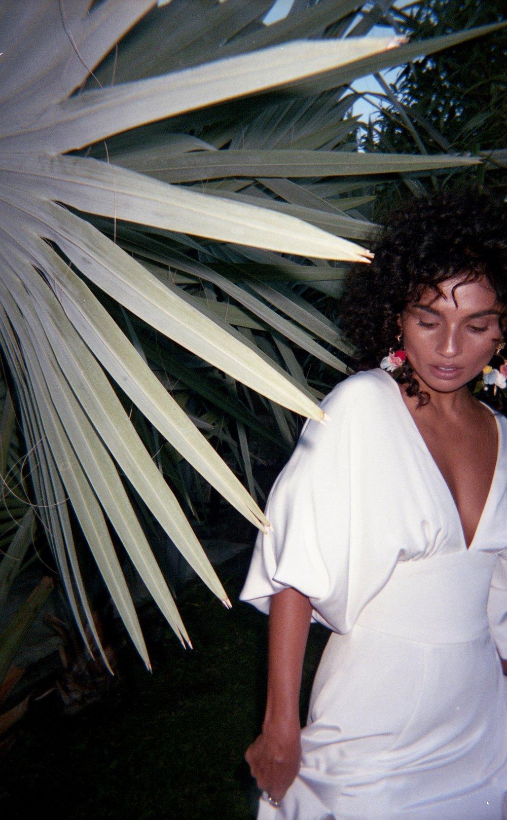 Fran Doll wears Mariposa Gown in Silk White.