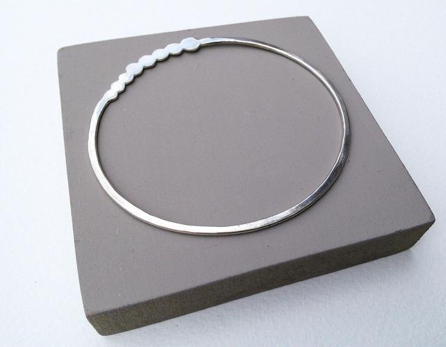 oval bangle with circles.jpeg
