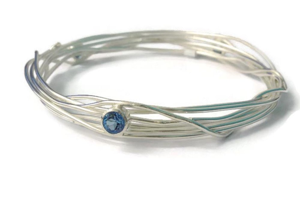 3 x aqua marine wrap bangle  £305