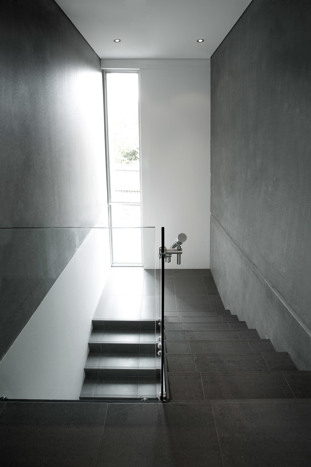 Minimalist interior stairs in black and white by Melbourne architecture photographer Stefan Postles