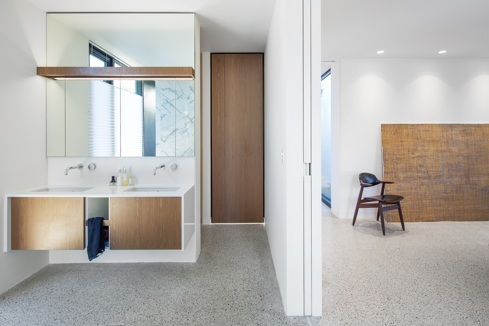 Modern ensuite bathroom with polished concrete floors by Melbourne architecture photographer Stefan Postles