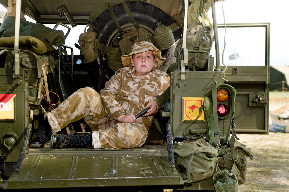 Boy in armoured vehicle, War and Peace show, Kent