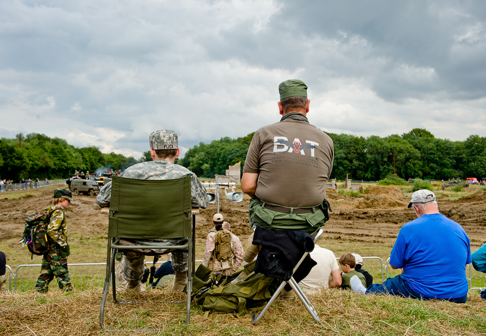 Father and son watching re-enactment of battle, War and Peace show, Kent