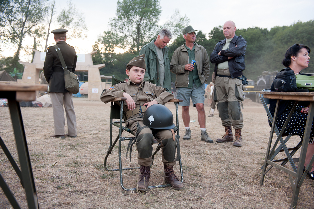 Young re-enactor watching period musical event at War and Peace Show, Kent