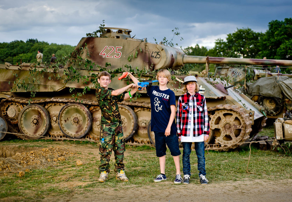 Boys posing near German WW2 tank, War and Peace show, Kent