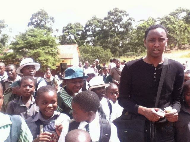 Abdul Adan with children from St Werburgh school