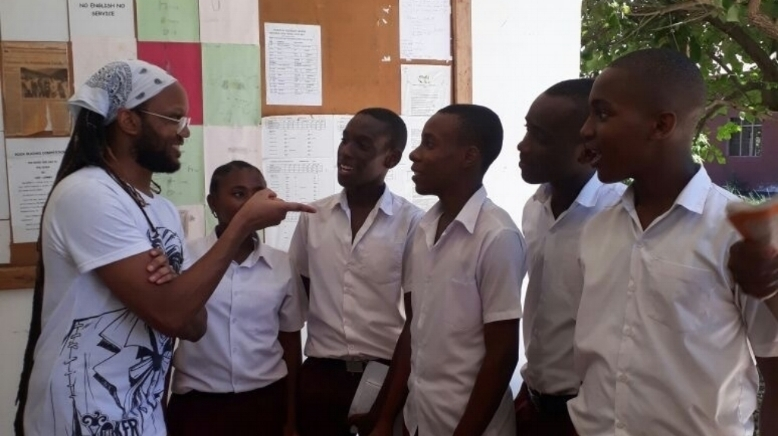 2017 Caine Prize workshop writer, Tendai Huchu, with students from Nianjema High School