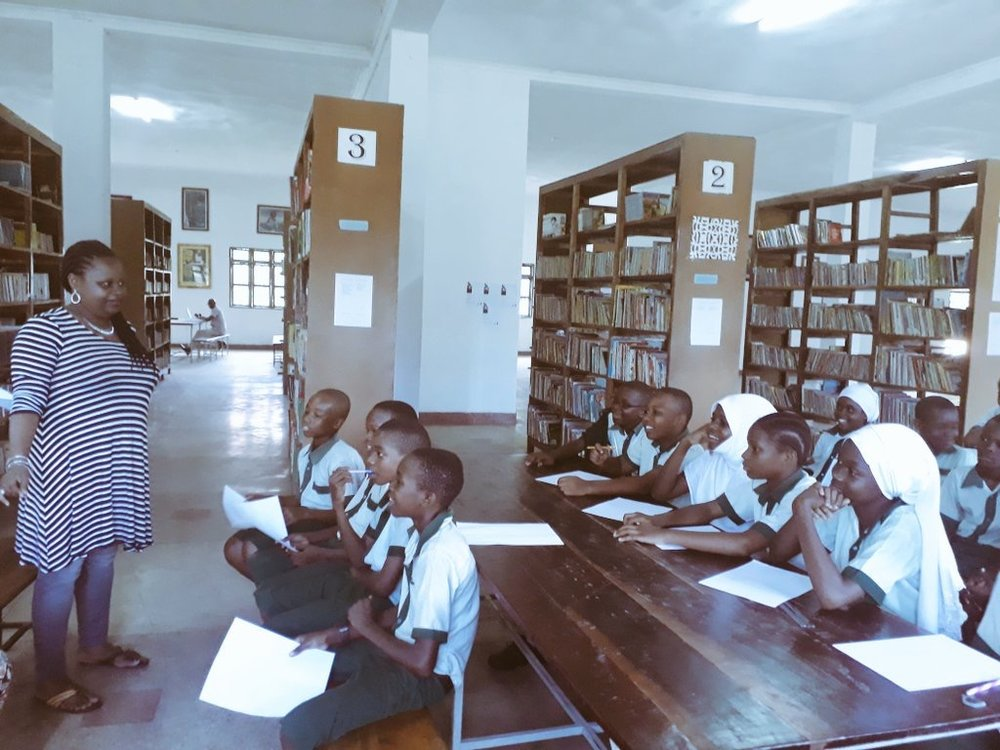 Esther Karin Mngodo speaking to pupils at English Medium school for this year's workshop in Bagamoyo, Tanzania. Photo courtesy by Esther Karin Mngodo.